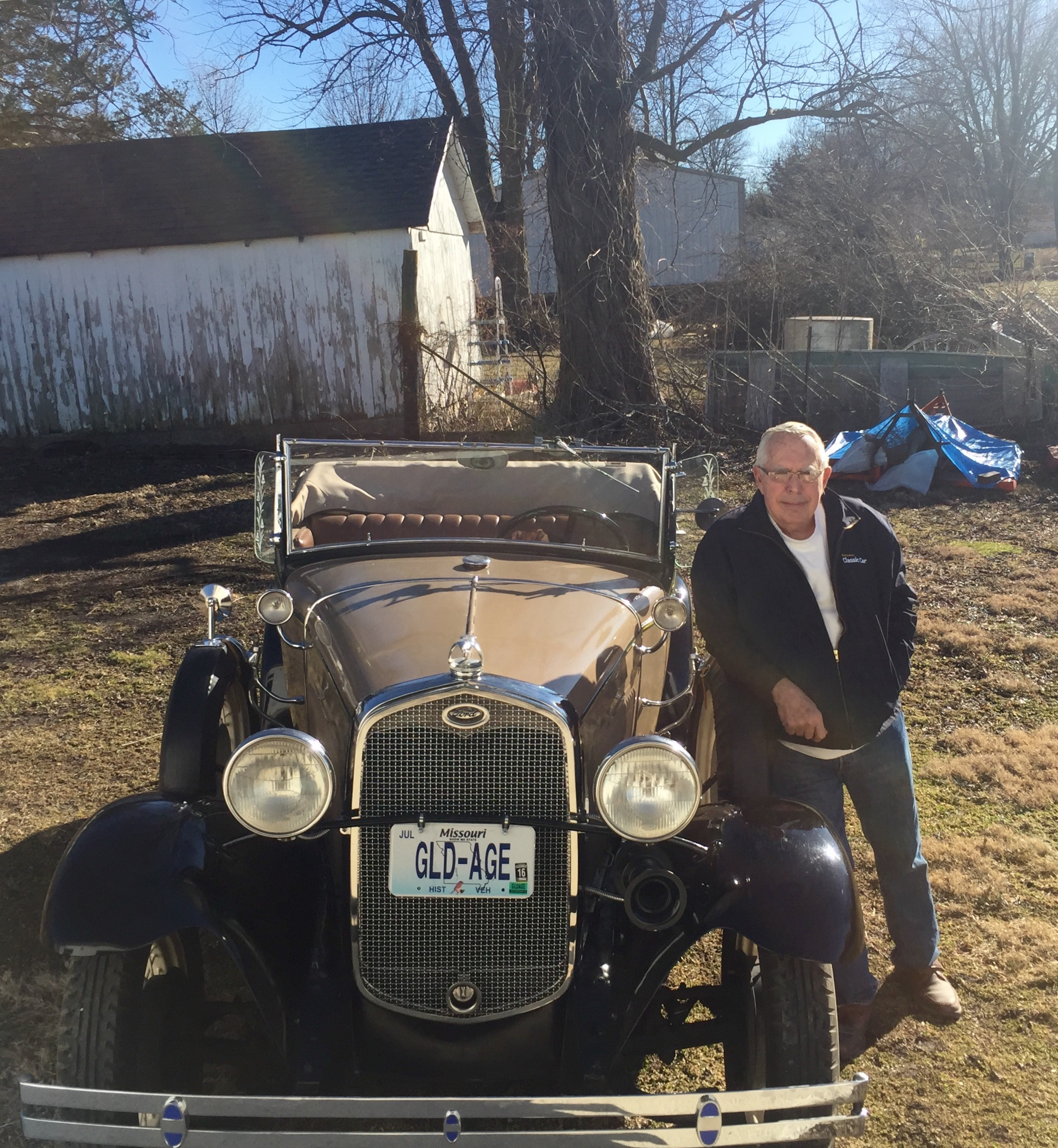 grandpa in front of his model a